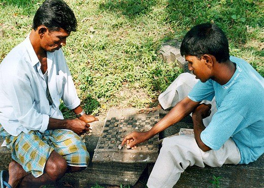 a couple of Sri Lankans playing on a home made board in Anuradhapura